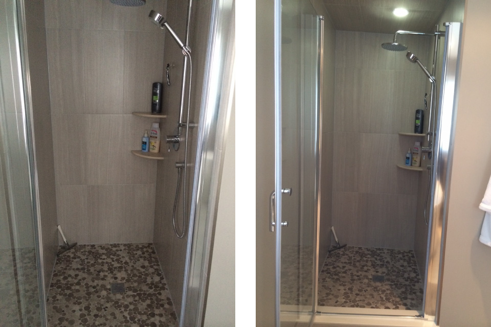 New shower with small tile flooring